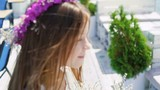 Little girl walks on the bar bay and spins with flowers. Slowly - 175469256
