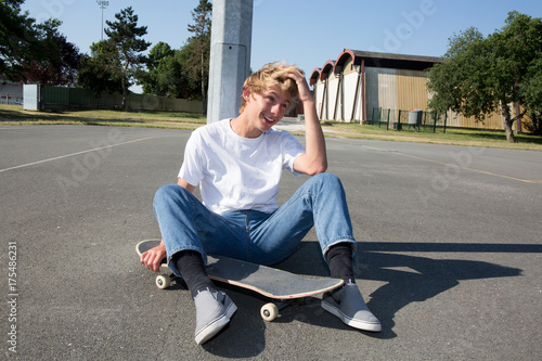 Fotobehang Skateboard A young skater resting on his board