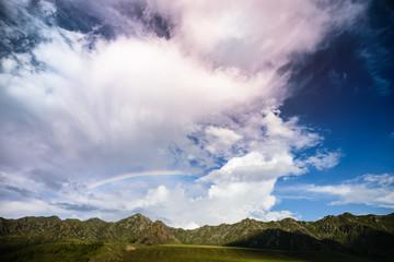 Evening rainbow sky over mountain tops
