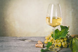 Glass of white wine on vintage wooden table - 175492833