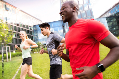 Young people in the city running together.