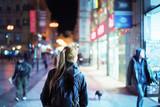 Back view of girl walking on city street at night, Prague - 175504299