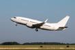 White passenger airplane takes off