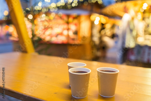 Poster Chocolade mulled wine in paper cups at christmas market