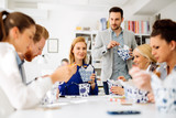 Business people eating in office - 175507403