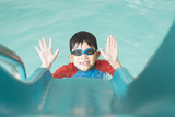 Asian happy kid playing slider in swimming pool - 175509279