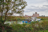 Porto Tolle, Veneto, Italy: view of the Po Delta Park with a fishing boat in the river - 175509647