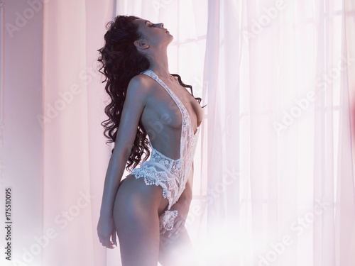 Tuinposter womenART Woman in lingerie at window