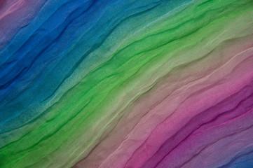 Texture of rainbow multi-colored silk