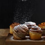 sprinkle with powdered sugar sweet rolls. morning breakfast - 175519629