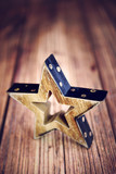 Wooden Christmas star on wooden background - 175521837