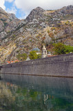 Skurda river and the fortress wall of the Old Town of Kotor in the autumn day. Montenegro - 175528660