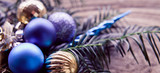 Violet, blue, silver, gold  and purple cold Christmas decorations with baubles. - 175529455