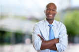 Laughing african american businessman with tie - 175530844