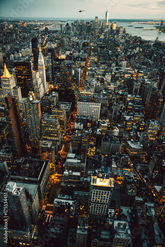 Naklejka Manhattan New York City buildings lights aerial top view at the night time