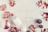 Fall beauty products flatlay on white marble table. Rose gold leaves, coconut oil, candles. Copyspace - 175539204