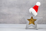 Christmas background. Christmas star and santa hat. Greeting card.