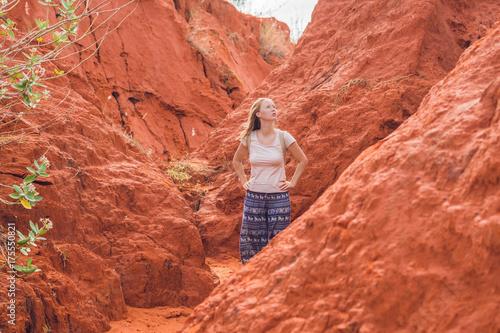 Poster Baksteen Young woman in red canyon near Mui Ne, southern Vietnam