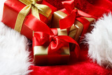 Small red and golden boxes with gifts tied bows - 175554674