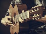 Closeup of man playing acoustic guitar - 175555005