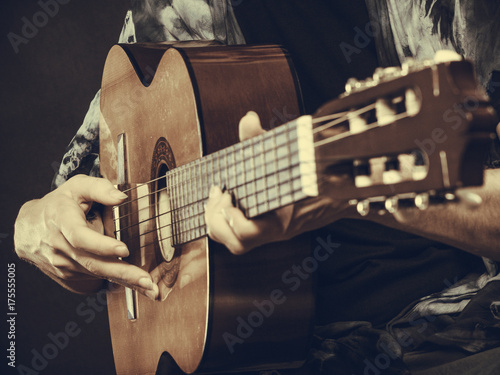 Closeup of man playing acoustic guitar Poster