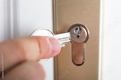 Hand Holding Broken Key Poster