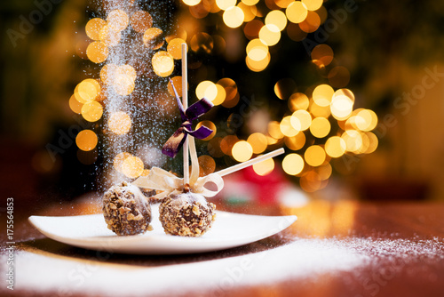 Christmas lollipop cake with falling sugar on a plate with blurry lights Poster