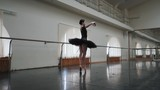 Ballerina in black tutu dancing classical pas in ballet gym. Woman alone practicing before performance. Slow motion. Young beautiful lady working out with amazing dance. - 175566608