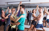girls and men learning salsa - 175571018
