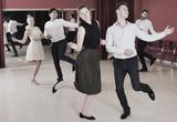 Positive people dancing twist in pairs - 175575047
