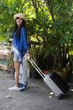 Asian thai woman wearing indigo art clothes for show and portrait with luggage at garden - 175578899