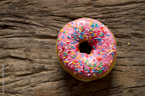 unhealthy but delicious sweet sugar donut cake on vintage wooden table in lifest Poster
