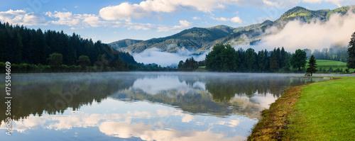 Foto op Aluminium Panoramafoto s Panorama of Alpine mountain summer lake at sunny foggy morning