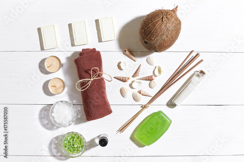 Papiers peints Spa Spa set with sea salt, essential oil, soap and towel decorated with seashells on white wooden background