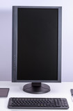 Black blank pc monitor turned vertical and keyboard on desk. - 175591829