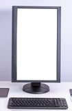 White blank pc monitor turned vertical and keyboard on desk. - 175591836