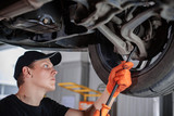 Specialist auto mechanic in the car service. - 175593444