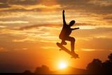 Skateboarder jumping at sunset. - 175593683