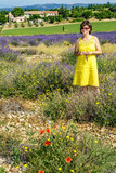 Woman in flowering lavender field - 175595465