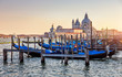 Gondolas on Grand Canal in Venice Italy sunset view Cathedral