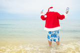 Funny Santa claus in the sea. Christmas in the tropics.  - 175599276