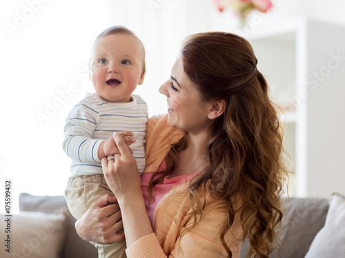 happy young mother with little baby at home - 175599432