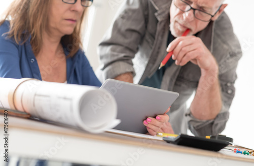 Fridge magnet Architects working on plans