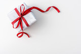 Christmas present with red dotted ribbon on white background
