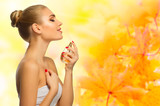 Healthy woman at autumnal background - 175617805