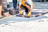 Work on laying paving slabs - 175624429