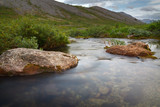 The rapid flow of the mountain river. - 175628881