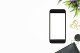 Smartphone with blank screen is on top of white table. Top view with copy space, flat lay. - 175629015