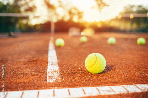 Fototapeta Tennis balls on clay court