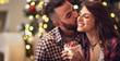 Man kisses woman while gives her Christmas gift